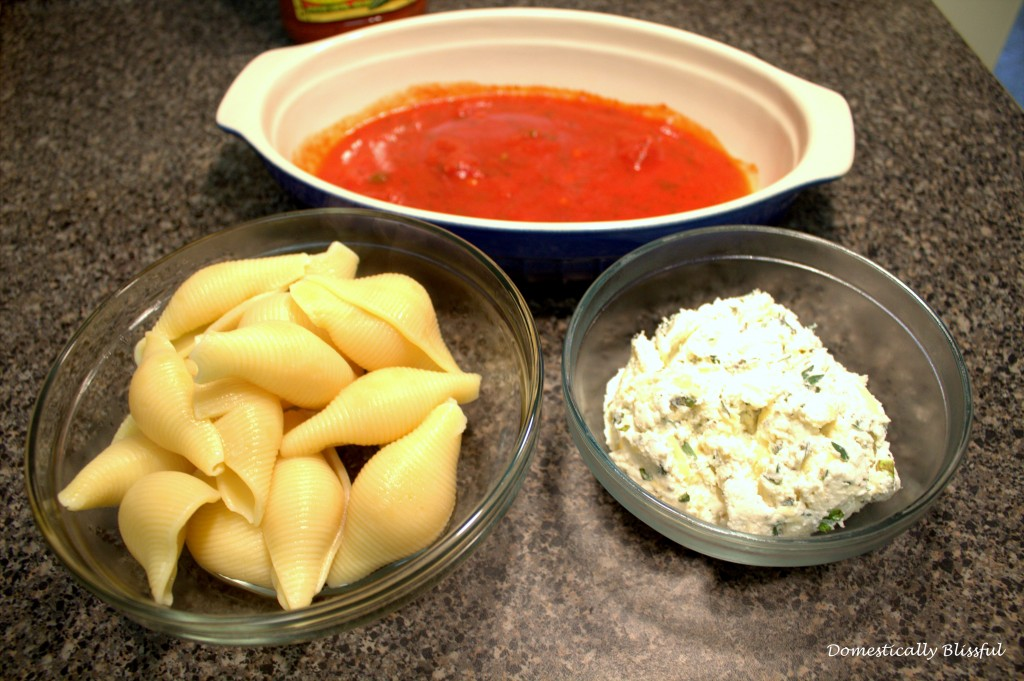Tomato Sauce and Cheese on top of Stuffed Shells with Herbed Ricotta ...