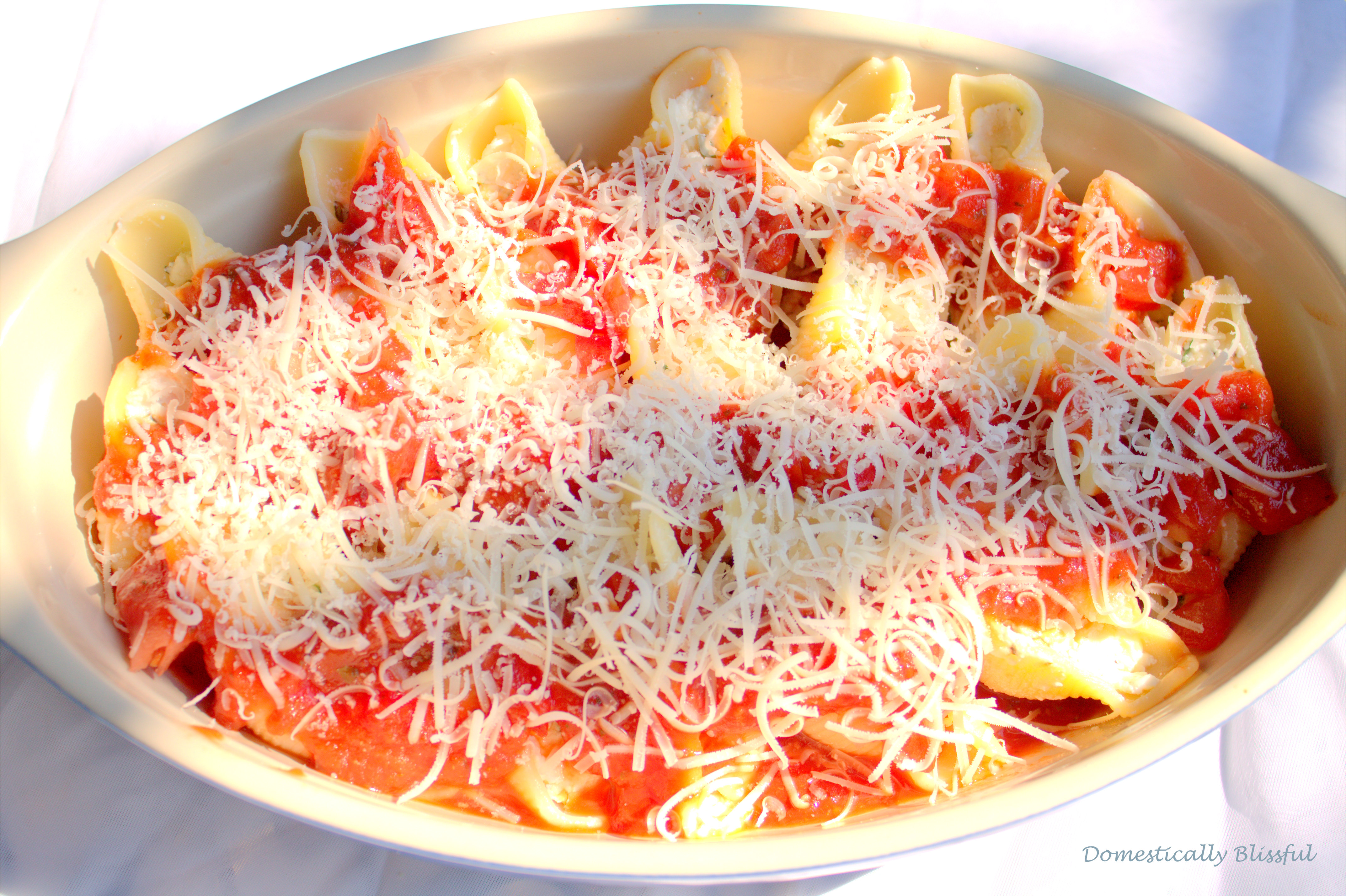 Tomato Sauce and Cheese on top of Stuffed Shells with Herbed Ricotta Cheese