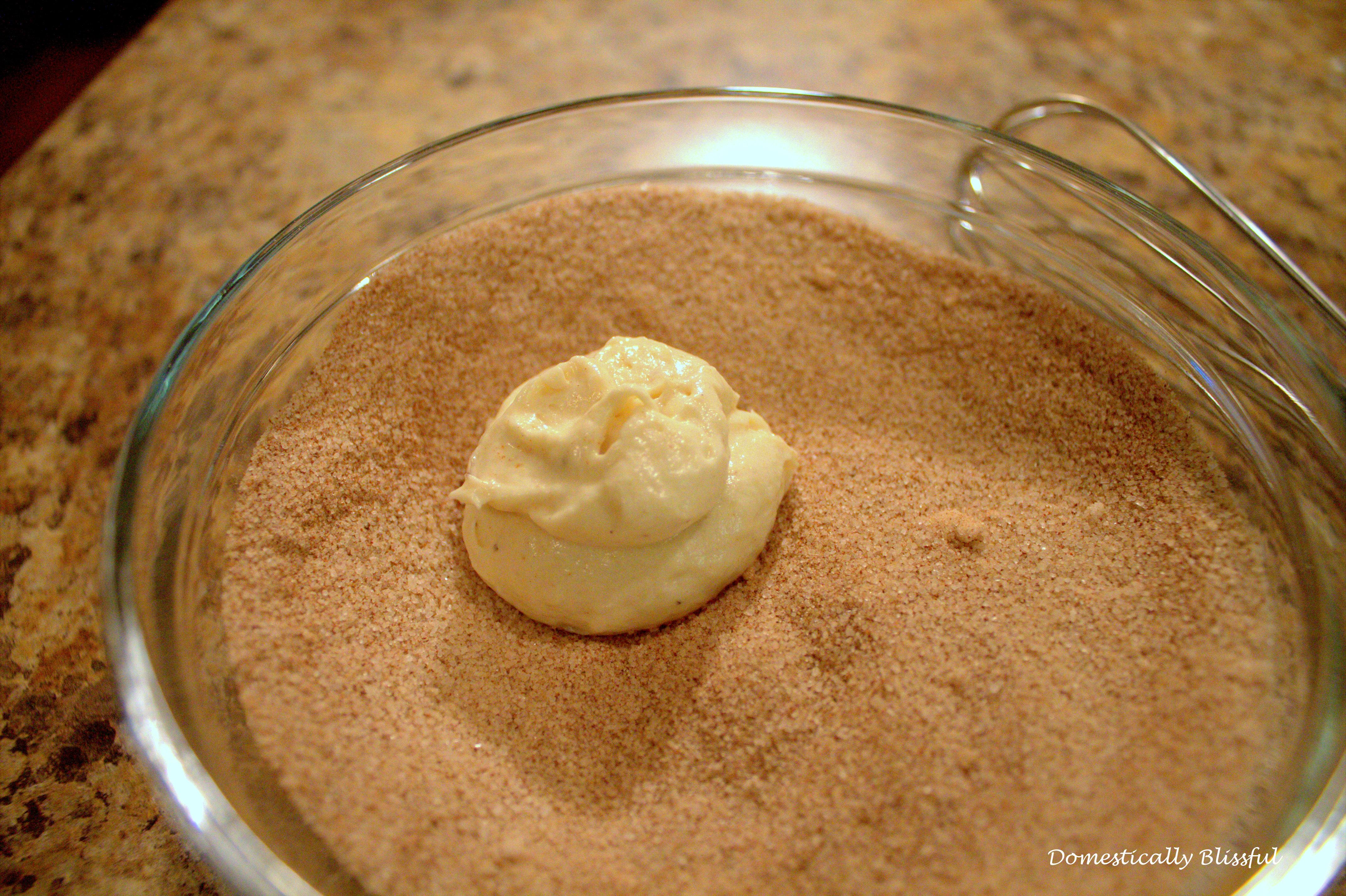 Roll the precooked muffins in cinnamon sugar