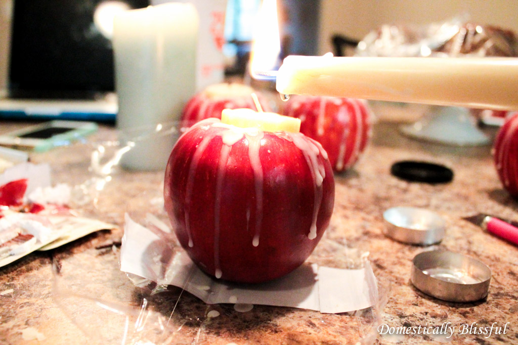Drip candle wax onto the apple