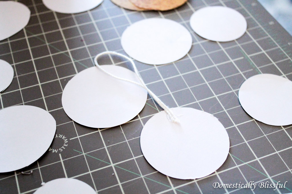 Hot glue the string to the circles
