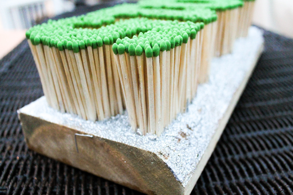 Matches stuck to wood