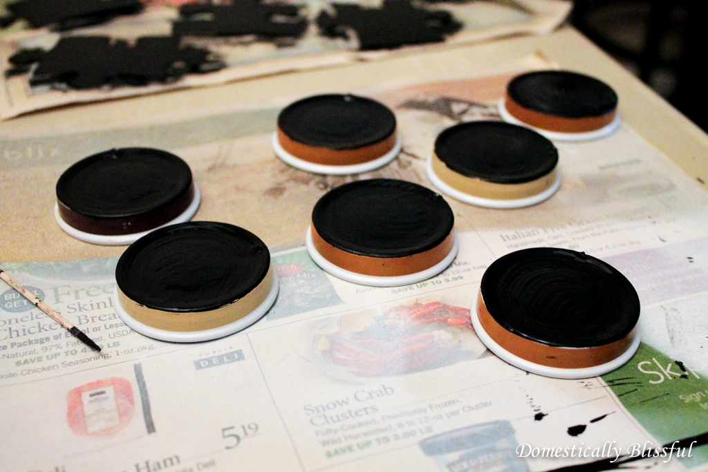 Paint the lids with chalkboard paint