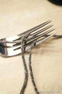 Yarn around fork for pom-poms