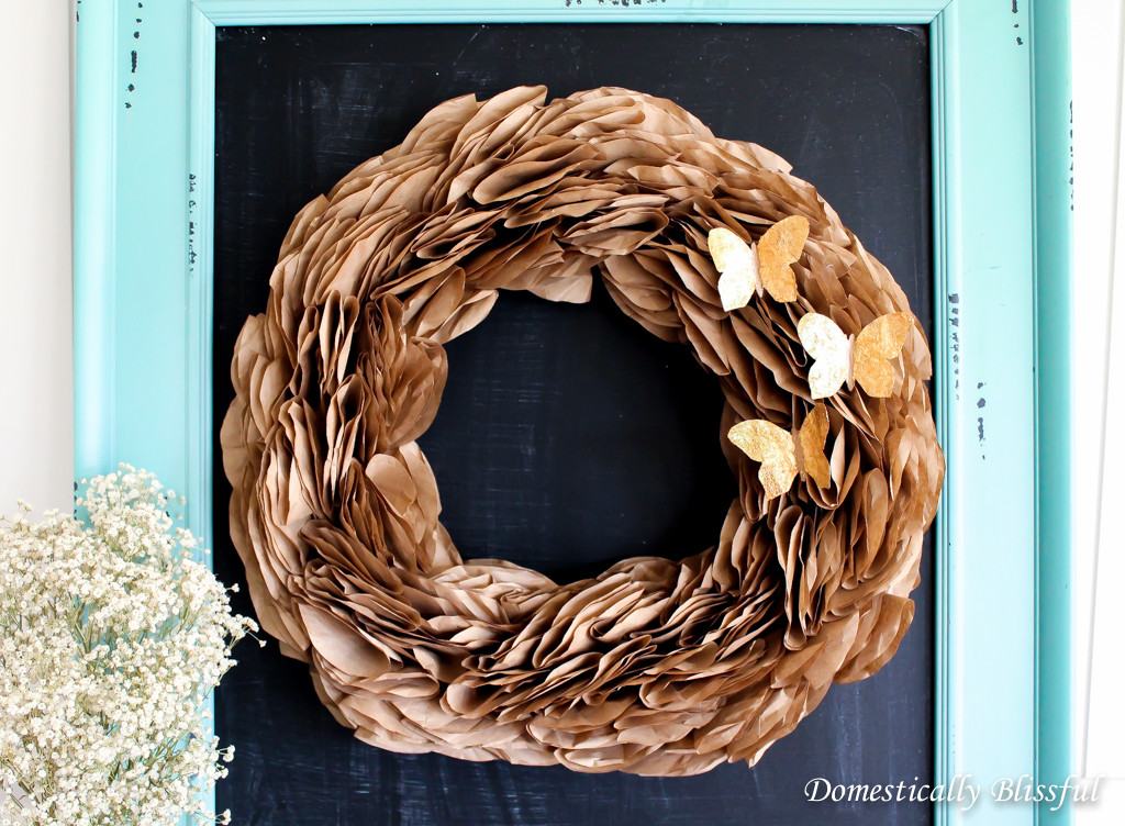 A simple Gold Butterfly Wreath made from recycled materials.