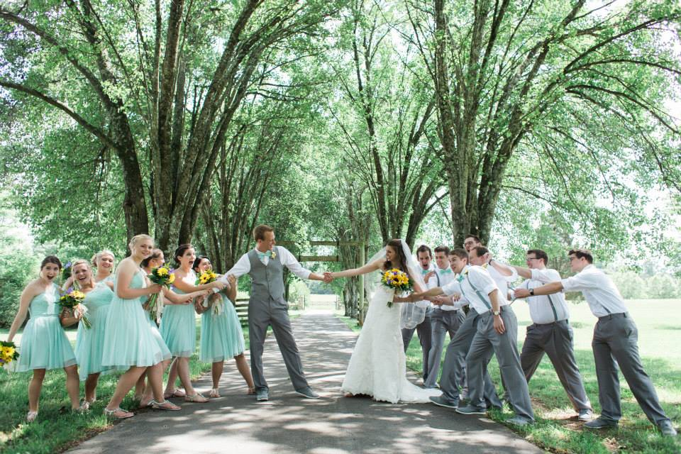 Tug of war with the bridesmaids and groomsmen
