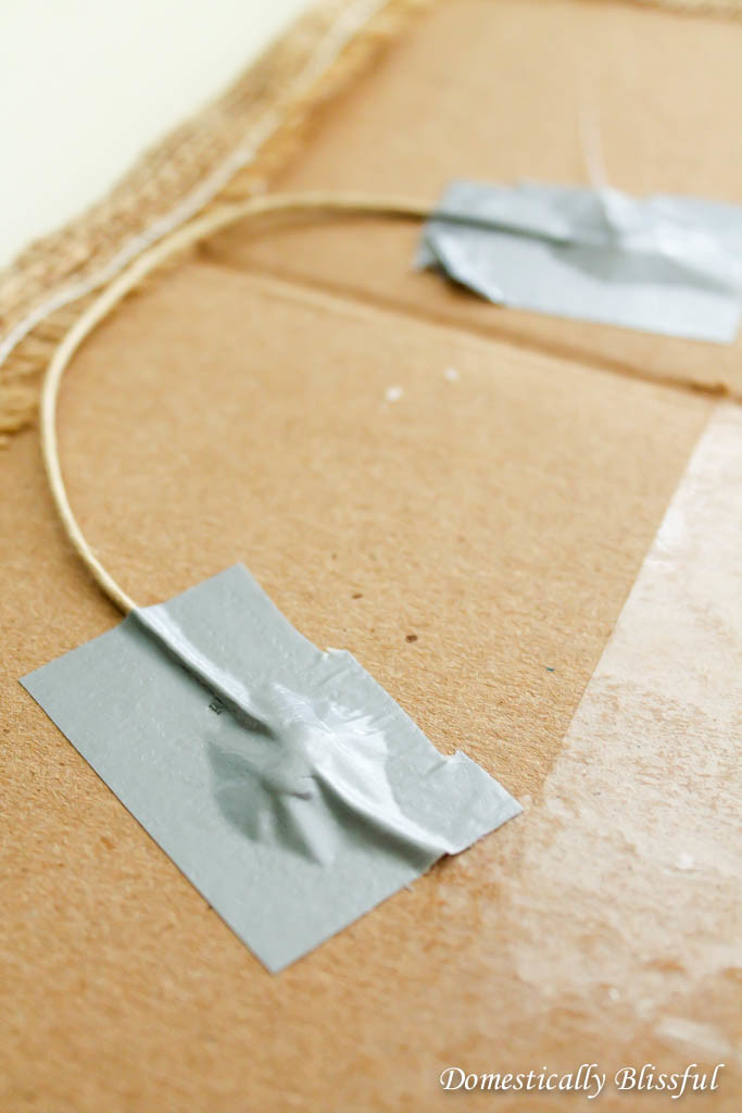 Ducktape twine to cardboard