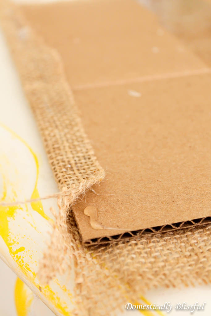 Hot glue burlap to the cardboard to make a canvas