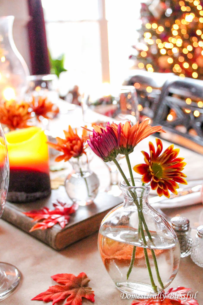 Fall flowers in little glass vases on Thanksgiving table