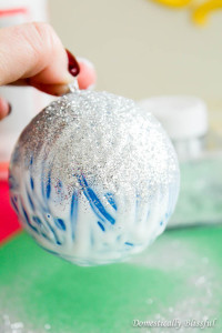 Add glitter to Christmas ornament