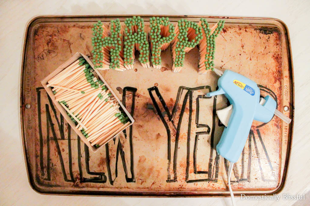 Happy New Year's Matches Sign on a baking sheet