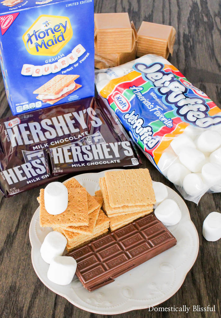 These Frozen Baked S'mores can be made last minute or ahead of time and left in the freezer to be enjoyed anytime as a way to cool off in the summer sun!