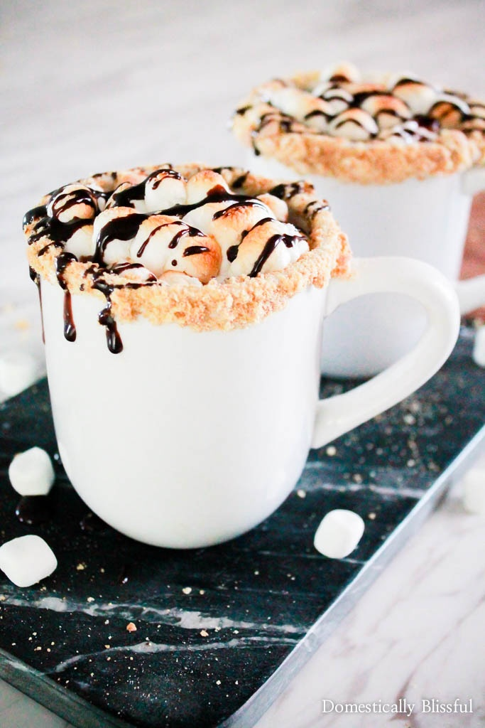S'Mores Hot Chocolate Recipe | Domestically Blissful - S'mores Hot Chocolate is a cup full of your favorite fall campfire treat that you can enjoy in the comforts of your own home.