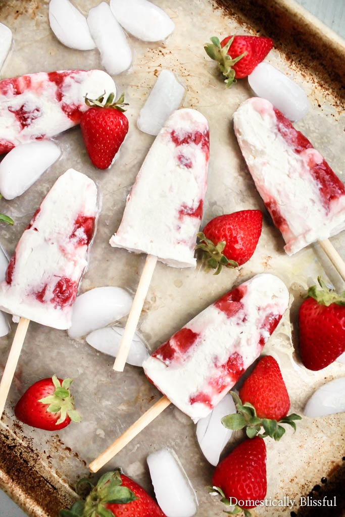 These easy homemade Strawberries & Cream Popsicles are a fun & delicious way to cool off while enjoying your favorite summer fruit!