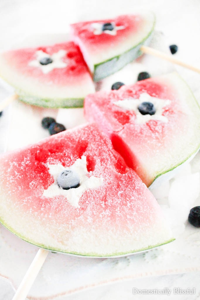 Frozen Patriotic Watermelon Pops arefilled with whipped coconut cream & a blueberry to create the perfect summer treat for any red, white, & blue occasion.