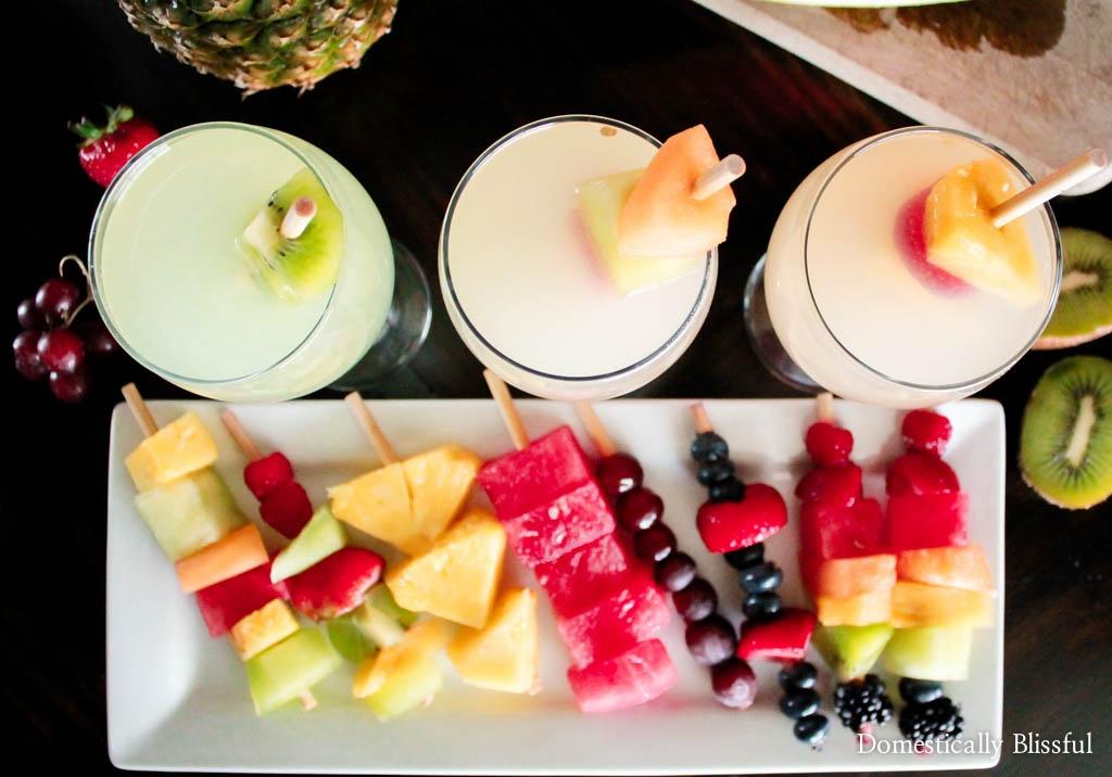 Frozen Fruit Skewers are a deliciously refreshing way to keep your drinks cold & enjoy your favorite fruit this summer!