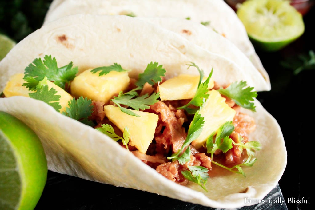 These vegetarian Pineapple Pulled Pork Tacos are sweet & tangy & topped with flavorful, colorful, & fresh ingredients for a delicious backyard summer meal!