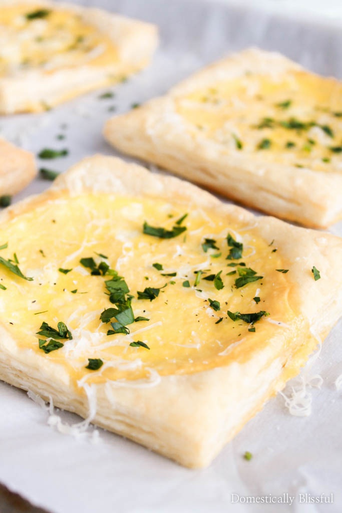 These Baked Egg & Goat Cheese Puff Pastries may look fancy, but they are super easy to create & are full of creamy flavors!