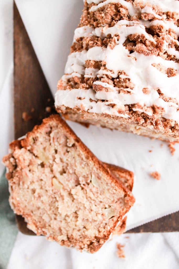 This Apple Cinnamon Banana Bread with streusel & icing drizzle is the perfect way to use up your extra apples & bananas & it makes your home smell as delicious as this bread tastes!
