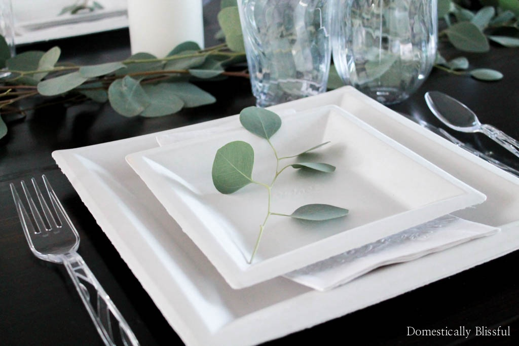 This fresh eucalyptus holiday tablescape is both elegant & very simple to create, which makes it perfect for any holiday party or dinner!