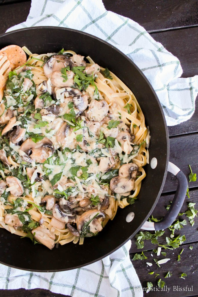 A quick & easy recipe for Creamy Mushroom Pasta with spinach & topped with parmesan cheese & fresh parsley.