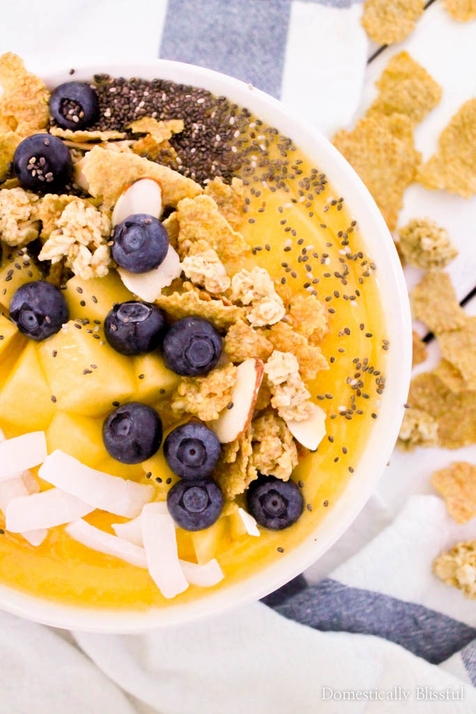 This Mango Coconut Almond Smoothie Bowl is filled with fresh tropical flavor & a delicious Great Grains Coconut Almond Crunch topping.