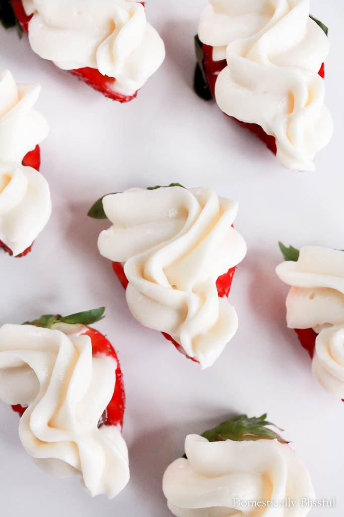These Nutella Cheesecake Strawberry Bites may look fancy, but they are a quick & easy dessert with Nutella hidden inside.