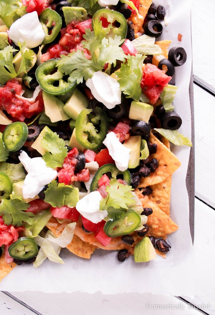 Loaded Vegetable Nachos is a quick & simple vegetarian meal that is filled with flavor & that everyone will love!