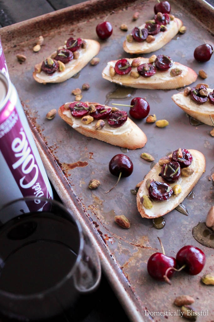 Cherry Goat Cheese Crostinis is a super simple warm appetizer made with roasted cherries, soft goat cheese, pistachios, & a drizzle of honey.
