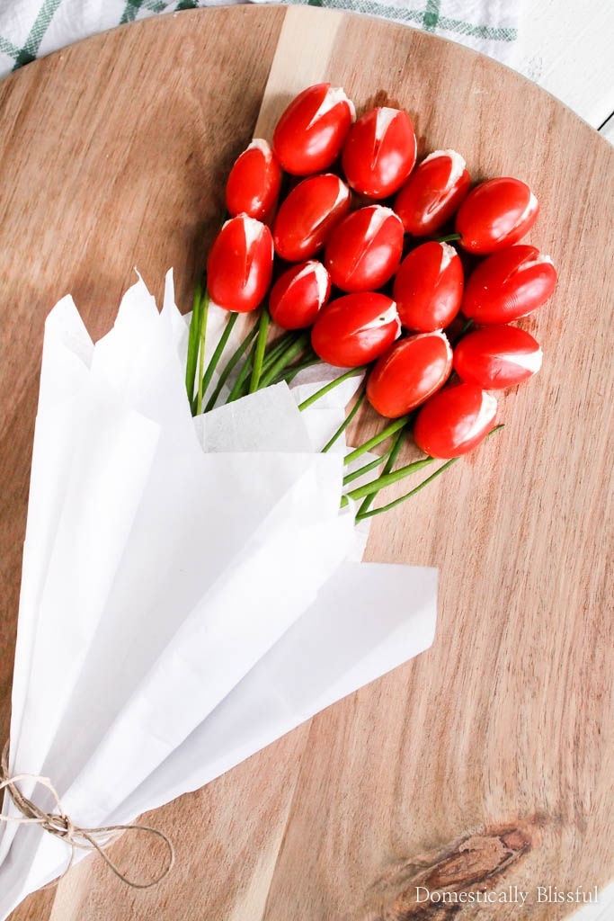This Cherry Tomato Tulip Bouquet is a bright & beautiful way to create a vegetable platter for your next spring party or Easter brunch!