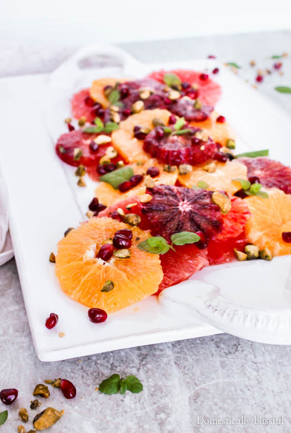 Enjoy your vitamin c this season through this beautiful & tasty citrus fruit salad garnished with pomegranate seeds, pistachios, mint, & a drizzle of honey!