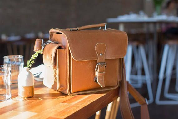 25 stylish camera bags you will love to carry your DSLR camera in when you travel.