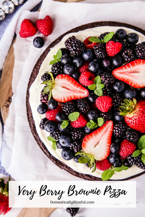 This Very Berry Brownie Pizza is covered with a homemade cream cheese icing & your favorite summer fruit making it the perfect dessert recipe for any summer party!