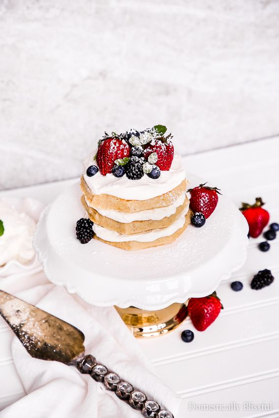 This Eggo Waffle Cake is quick & easy to make with layers of homemade whipped cream & topped with fresh berries making it perfect for a special brunch or a fun party dessert!
