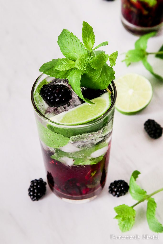 This Virgin Blackberry Mojito is sure to be your new favorite summer drink for date night in, 4th of July, or a party with your friends & family.