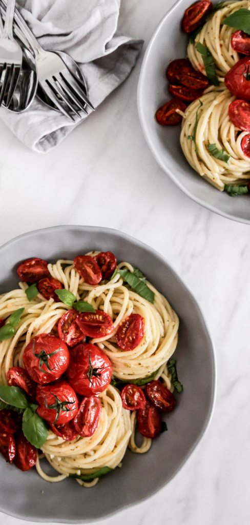 This Roasted Tomato Lemon Pesto Pasta is tossed in freshly squeezed lemon & pesto & then topped with oven roasted tomatoes for an array of delicious summer flavors.