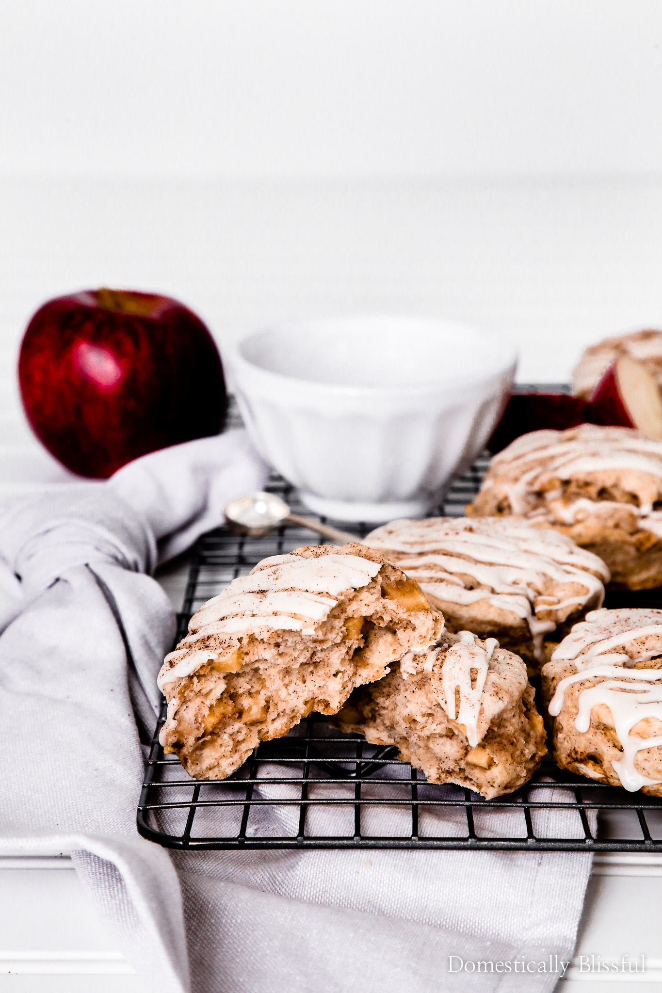 These homemade Cinnamon Apple Biscuits will fill your home with the fragrance of fall. Each bite is filled with apple cinnamon pieces making them the perfect autumn recipe for breakfast, brunch, or even dessert!