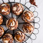 These Nutella Cream Cheese Swirl Pumpkin Muffins are the best fall recipe for breakfast, brunch, or even dessert because they are filled with pumpkin spice flavors & a swirl of Nutella & cream cheese on top.