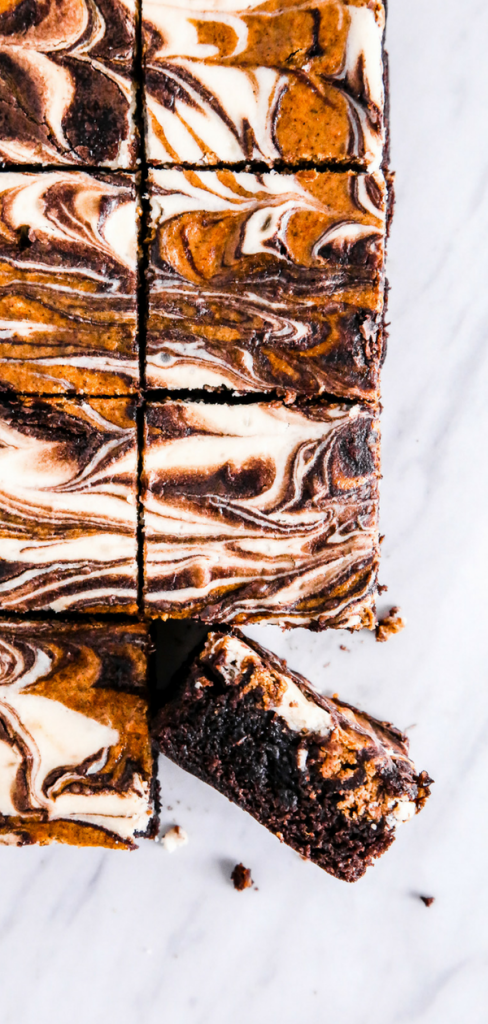 These Pumpkin Spice Cheesecake Brownies are rich, creamy, & full of the best fall flavors. This easy dessert is made even easier with a brownie box mix & a simple homemade pumpkin cheesecake recipe.