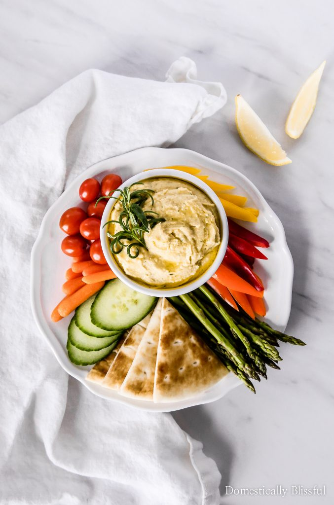 TThis Lemon Rosemary Hummus is bursting with fresh flavor & pairs perfectly with colorful vegetables & DASANI® Sparkling.
