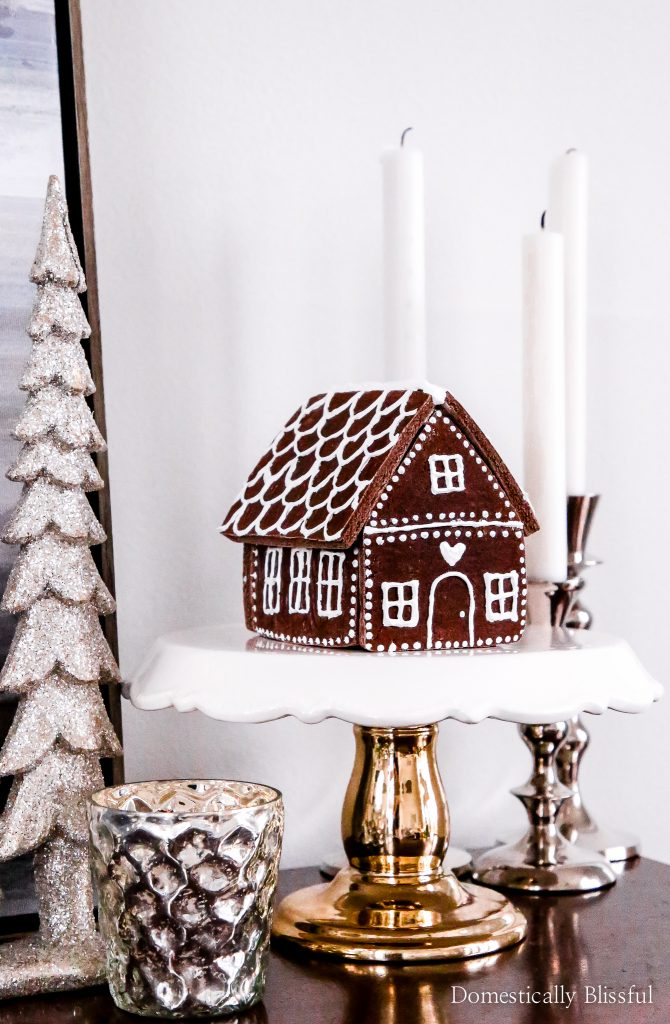 This DIY Cinnamon Salt Dough Gingerbread House will make your home smell amazing & is a beautiful keepsake that you can decorate your house with year after year.