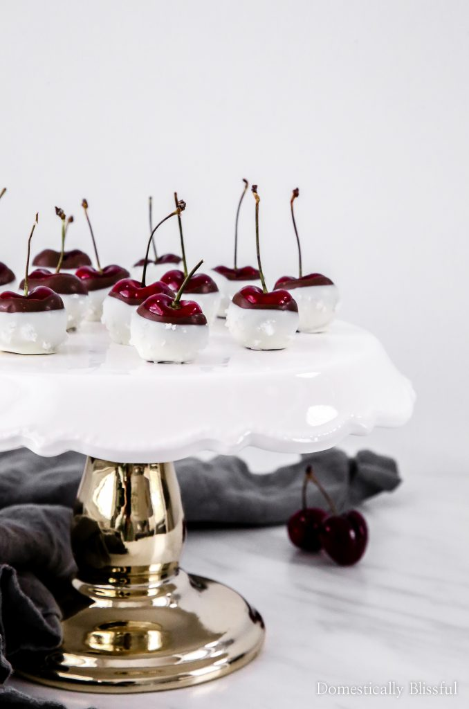 These Sea Salt Chocolate Cherries are dipped in dark chocolate & white chocolate before being sprinkled with sea salt. This quick dessert recipe is sure to be a crowd pleaser for your next holiday party or summer date night!