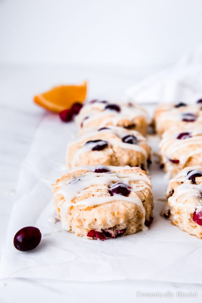 These Orange Cranberry Buttermilk Biscuits are the perfect winter brunch recipe with soft flaky layers of fresh cranberries & orange zest that are ready to eat in only 30 minutes!