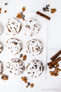 These Iced Raisin Bran Cookies are the perfect holiday cookie recipe with its chewy center, crisp edges, sweet cinnamon flavor, & snowy icing.