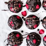 These Double Chocolate Raspberry Muffins are perfectly indulgent. From the fluffy dark chocolate muffin to the rich dark chocolate chips to the sweet fresh raspberries, this muffin recipe is divine!