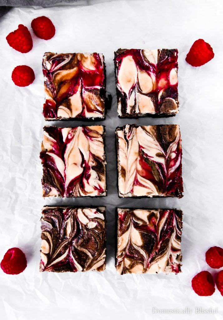 These Raspberry Cheesecake Brownies have a homemade creamy cheesecake, sweet raspberries, & a rich chocolate brownie that make it the perfect dessert for summer parties & Valentine's Day.