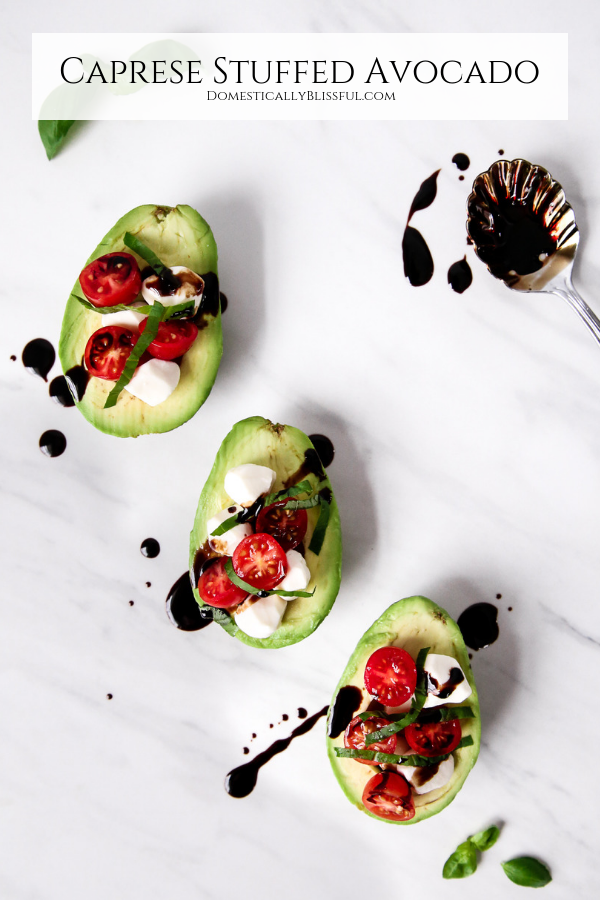 This Caprese Stuffed Avocado is the perfect little vegetarian appetizer for your next dinner party or date night at home.