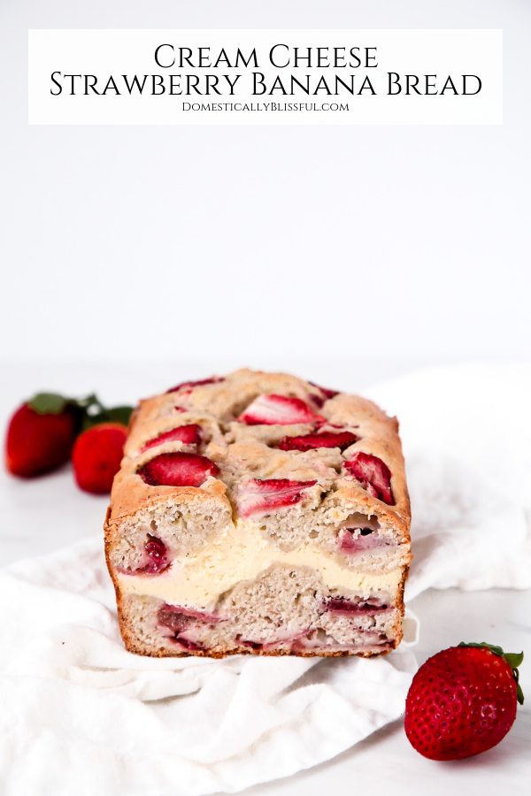 ThisCream Cheese Strawberry Banana Bread has a layer of sweet cream cheese between two layers of fresh strawberry banana bread.