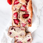 This Cream Cheese Strawberry Banana Bread has a layer of sweet cream cheese between two layers of fresh strawberry banana bread.