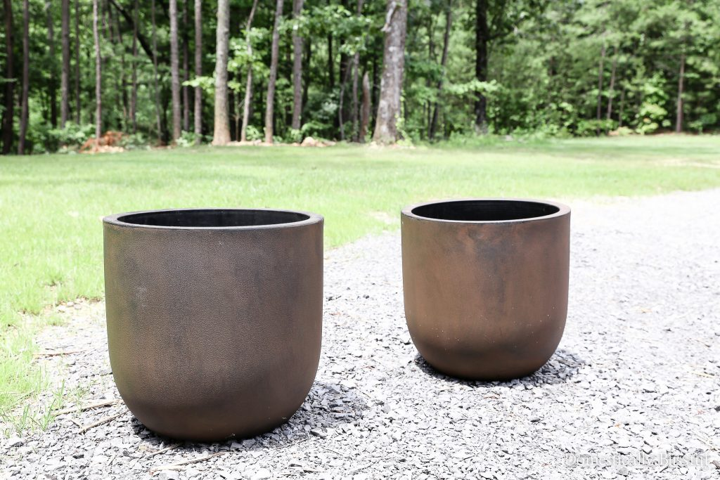DIY Faux Concrete Pot Planters in 15 minutes for WAY less than the price of real concrete pot planters.